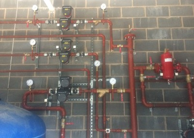 Standard plant room with vertical header, shut pump, VT & CT circuits etc at Eversfield Prep School